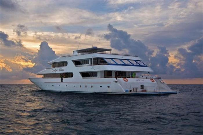 The Carpe Vita during a beautiful Maldivian sunset. Click the image to learn more about this vessel.